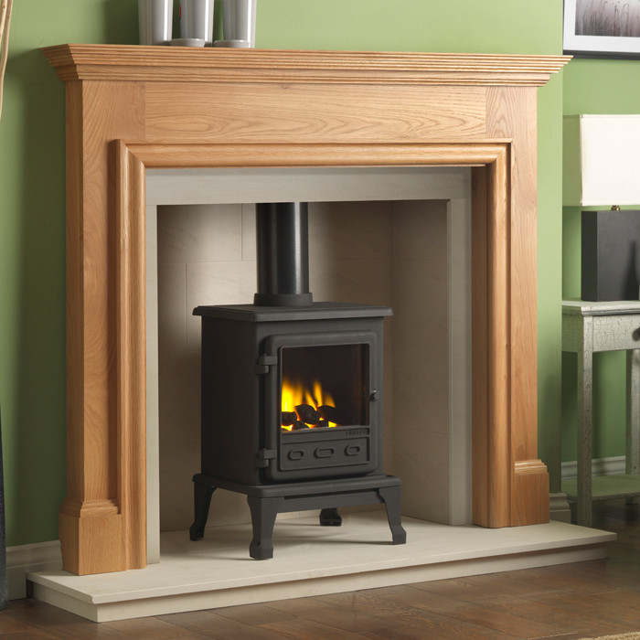 "The Gallery Howard Oak Fireplace with optional Firefox 5 Gas Stove consists of the Howard 54"" oak surround"